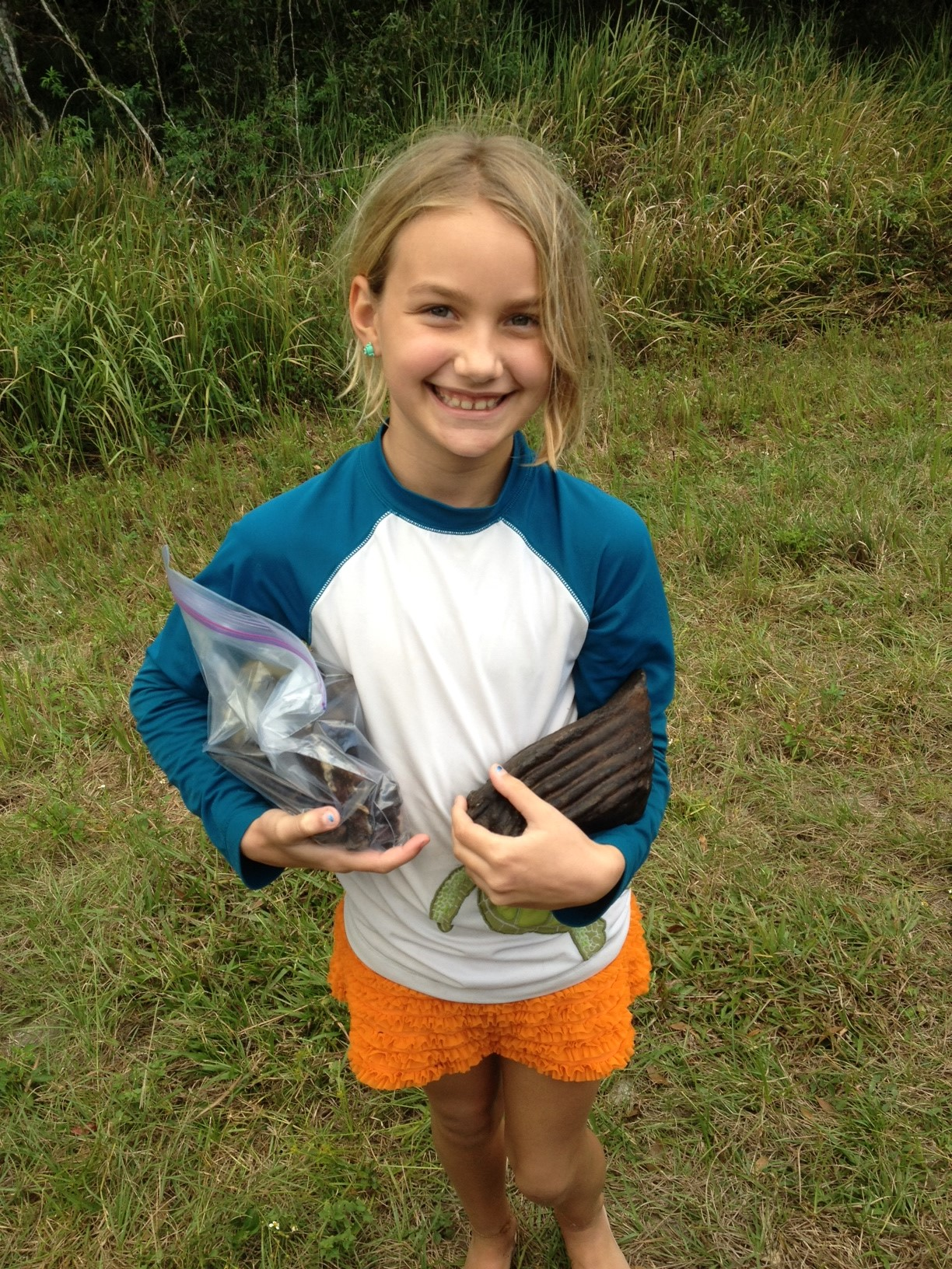 Syndal D. with her big bag of fossils and her new Mammoth tooth. Nov. 2014